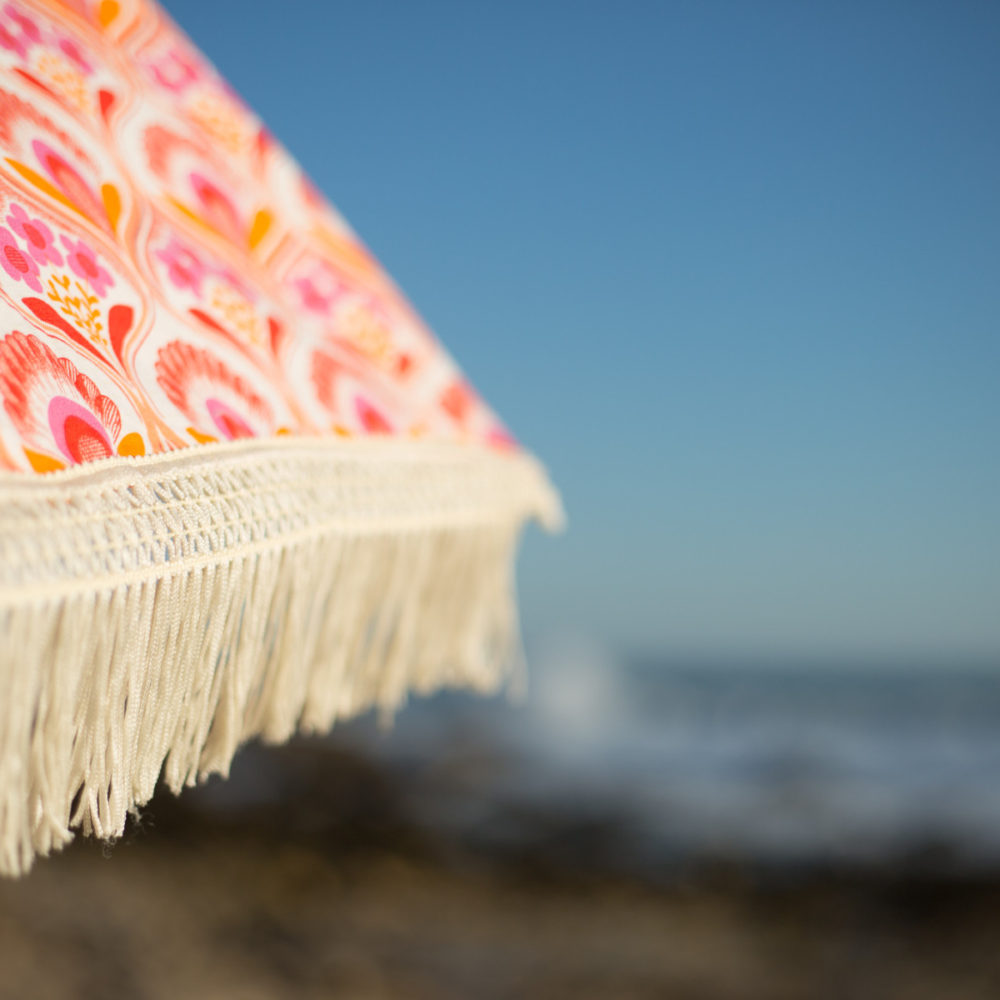 Thalia-Coral beach umbrella available at beachbrella.com