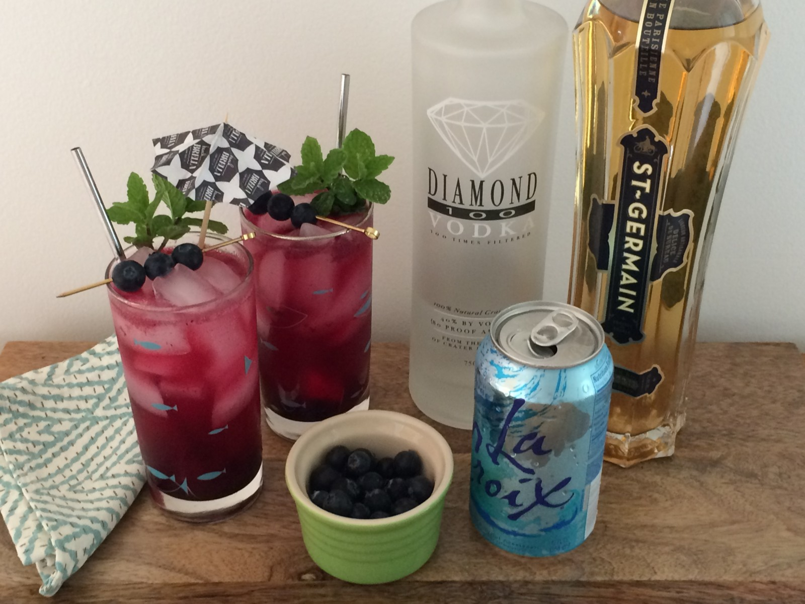 Two glasses of Spiked Blueberry Soda