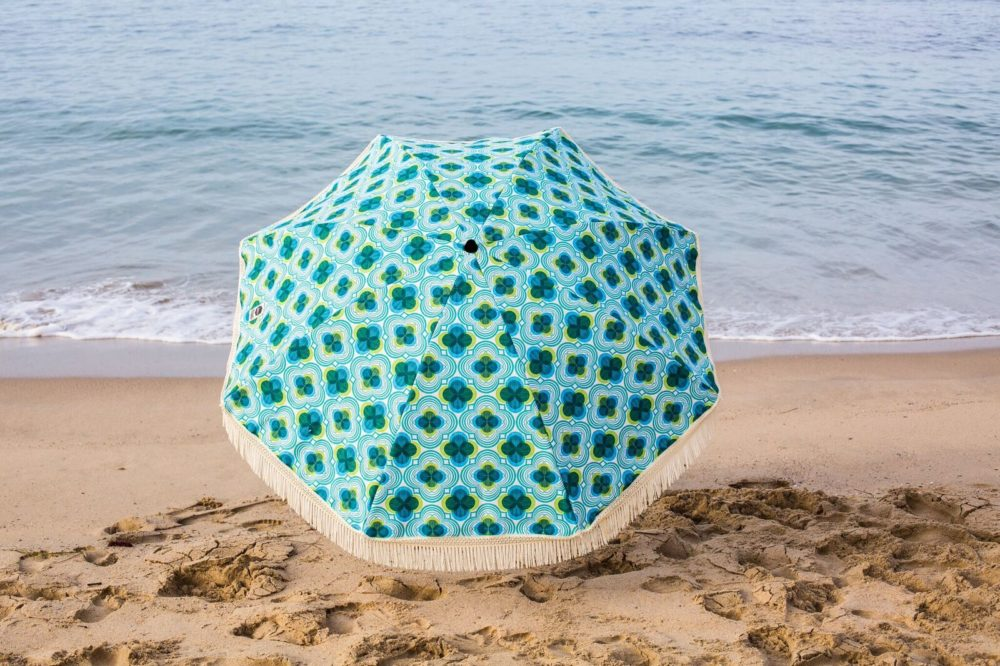 blue and green beach umbrella