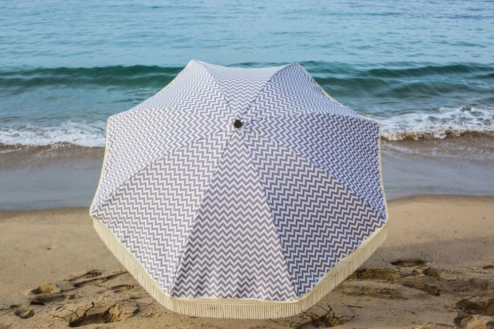 grey and white luxury beach umbrella
