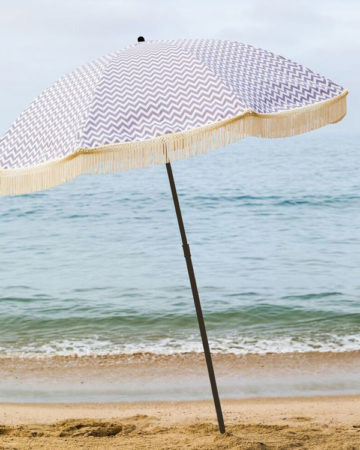 grey and white beach umbrella with fringe, beach umbrella, beach accessory, parasol, brolly, beach brella, uv protection