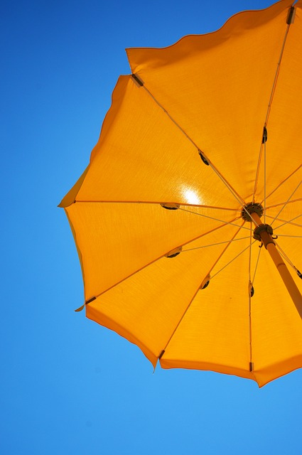 Bright Yellow Beach Umbrella against sky