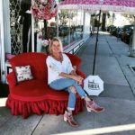 Pink Beach Umbrella with Shelley Arends on a pink couch