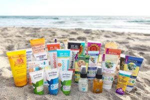 a variety of organic sunscreens on the beach