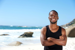 man on beach in muscle tee