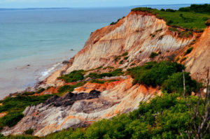 Beautiful orange clay cliffs cascading down to the ocean
