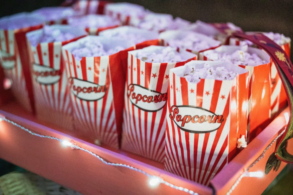 Bags of popcorn in a tray with lights for movie night family backyard fun