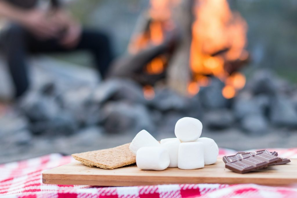 S'more ingredients in front of a campfire
